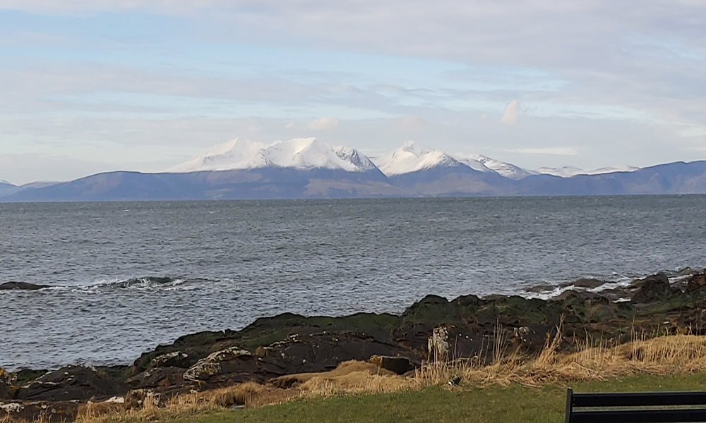 Isle-of-Arran-in-Scotland-with-Snow-Capped-Mountains-in-the-winter